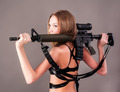 Beautiful sexy blond woman holding army rifle over grey background - PhotoDune Item for Sale