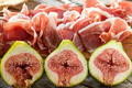 Fresh figs with ham on a white plate - PhotoDune Item for Sale