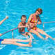 Family in the swimming pool. - PhotoDune Item for Sale