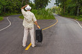 a man with a suitcase is on a fork in the road - PhotoDune Item for Sale