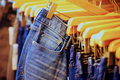 Row of hanged blue jeans in a jeans shop - PhotoDune Item for Sale