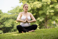Pregnancy and motherhood-pregnant woman doing yoga - PhotoDune Item for Sale