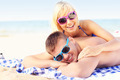 Couple sunbathing at the beach - PhotoDune Item for Sale