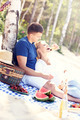 Romantic couple having picnic at the beach - PhotoDune Item for Sale