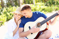 Romantic couple and guitar on the beach - PhotoDune Item for Sale