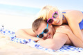 Joyful couple sunbathing at the beach - PhotoDune Item for Sale
