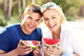 Happy couple with watermelon at the beach - PhotoDune Item for Sale