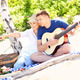 Happy couple on the beach with guitar - PhotoDune Item for Sale