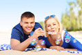 Young couple blowing bubbles at the beach - PhotoDune Item for Sale