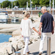 Couple strolling past a small boat harbour - PhotoDune Item for Sale