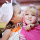 Little girl kisses sister. - PhotoDune Item for Sale