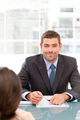 Happy businessman during an interview with a female colleague