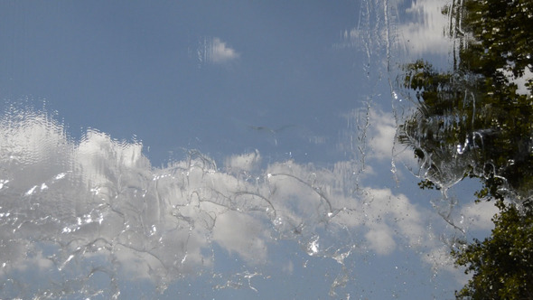 Clouds Seen Through a Waterfall