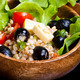 wood bowl with spelt salad with olives and tomatoes - PhotoDune Item for Sale