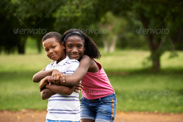 children african boy and girl in love hugging - Stock Photo - Images