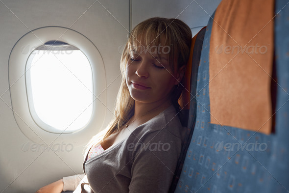 people travelling relaxed woman sleeping on plane - Stock Photo - Images