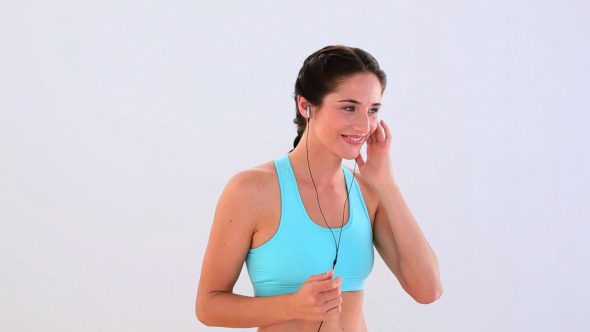 Fit Brunette Listening To Music And Dancing