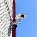 video surveillance camera on a wall of the building - PhotoDune Item for Sale