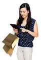 Woman with shopping bag and touch on tablet - PhotoDune Item for Sale