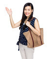Asian woman with shoulder bag and hand present something - PhotoDune Item for Sale