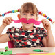 happy little girl makes paper mustache - PhotoDune Item for Sale