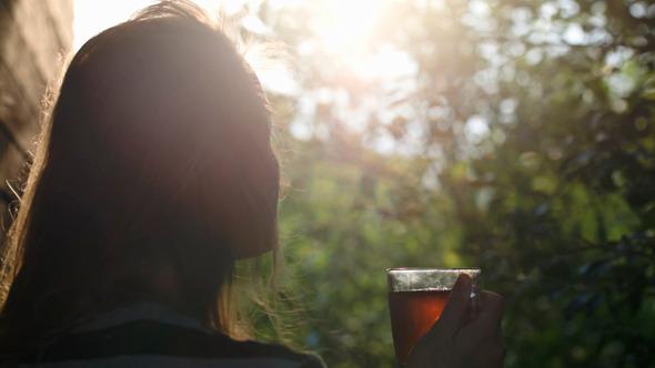 Woman Having Tea Outdoor During Sunset