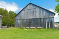 Old wooden barn against a blue sky. - PhotoDune Item for Sale
