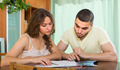 Young couple calculating budget - PhotoDune Item for Sale