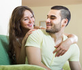 Adult couple on sofa in home - PhotoDune Item for Sale