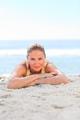 A woman sunbathing at the beach