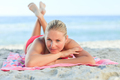 Beautiful woman lying down on the beach