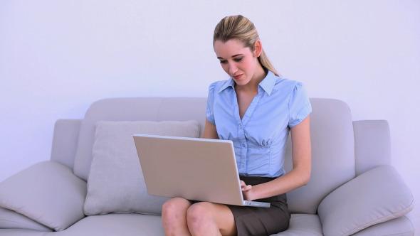 Stylish Thoughtful Businesswoman Using Laptop