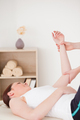 Portrait of a young woman having an arm massage