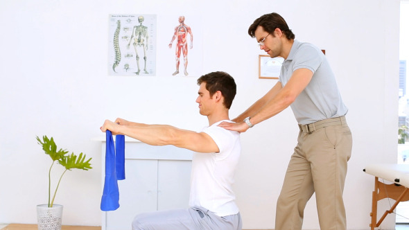 VideoHive Physiotherapist Checking Shoulders Of Patient 8295107