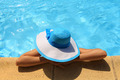 Young lady with white blue hat by the poolside - PhotoDune Item for Sale
