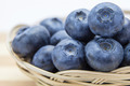 Macro shot of fresh ripe blueberries in wicker basket - PhotoDune Item for Sale