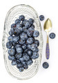 Fresh blueberries in oval glass dessert bowl and spoon - PhotoDune Item for Sale