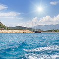 scenic seascape, blue sky, sun, yacht - PhotoDune Item for Sale