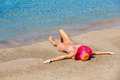 Woman relaxing on tropical beach - PhotoDune Item for Sale