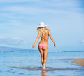 Woman walking on tropical beach - PhotoDune Item for Sale