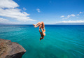 Woman doing backflip into ocean - PhotoDune Item for Sale