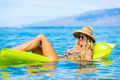 Young woman floating on raft - PhotoDune Item for Sale