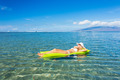 woman floating on raft  - PhotoDune Item for Sale