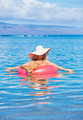 Woman floating on raft in tropical ocean - PhotoDune Item for Sale