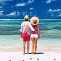 Couple on a beach at Seychelles - PhotoDune Item for Sale
