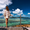 Woman on a beach jetty at Seychelles, La Digue. - PhotoDune Item for Sale