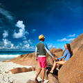 Couple at tropical beach wearing rash guard - PhotoDune Item for Sale