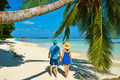 Couple in blue clothes on a beach at Maldives - PhotoDune Item for Sale