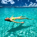 Woman in bikini lying on water - PhotoDune Item for Sale