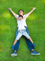 happy father and son lying on a meadow together in the park - PhotoDune Item for Sale